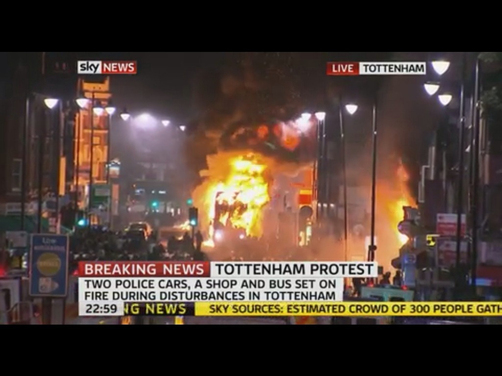 neighborhoodr-london:  Bus on fire in Tottenham, London riots. More at BBC.  Photo via Sky News TV capped by JonathanHaynes Additional reports from Guardian