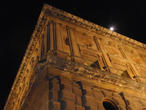 Corner of building with moon.