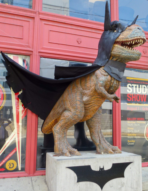 ianbrooks:  Dino Bat Sculpture in Pittsburg This cosplaying dino is from 2003's Dinomite Days, when 100 Fiberglass dinosaurs were installed in the city and then auctioned for charity. Presumably, the Art Institute of Pittsburgh decided to dress this one up in celebration of the Dark Knight Rises being shot in the city. (photo via Anirudh Koul)  Well done, Pittsburgh. Well done.
