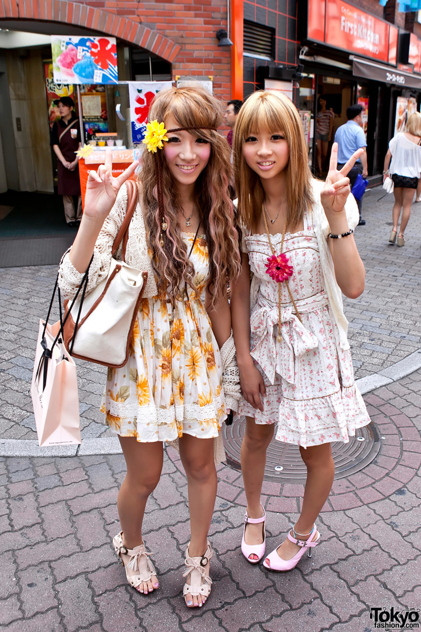 Friendly blonde Shibuya girls in floral summer fashion.