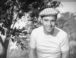 Pretending to be a model dressed in golf gear in 'Marriageable Male' (1952)