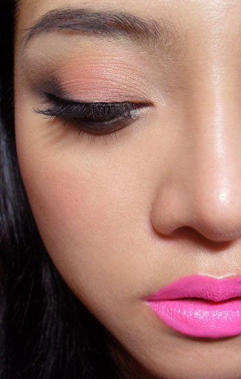 Warm eyes, cool lips: Wet n Wild Greed Palette with Lime Crime Countessa Fluorescent lipstick —-   I often wear cool eyes with warm lips, but not the reverse, so I decided to try simple, coral-toned lids with super-bright blue-pink lips. Do note that the camera does bring out the white pigments in the lipstick and make it look paler and more pastel than it really is. It's actually stronger and brighter. —- Step 1: Apply the matte coral-beige shade to the center of the lids, leaving the outer and inner corners empty.  Step 2: With a dark metallic grey (I used I Nuovi Dust in Titanium, but any deep grey will do), apply just to the outer corners, slanting in. Drag along the lower lash line as well.  Step 3: Apply black liquid liner to the upper lash line and end in a short flick at the outer corners.   Step 4: Apply false lashes and/or black mascara. I'm using my trusty Ardell 120 Demi Wispies.  —- Other products used: Bourjois Healthy Mix Foundation #52 Yves Saint Laurent Touche Eclat #2 (not recommending this; I'm just using it up) Make Up For Ever HD Powder NYX Silky Rose blush No 7 Extreme Length Mascara (definitely recommended!) Lime Crime Countessa Fluorescent Opaque lipstick