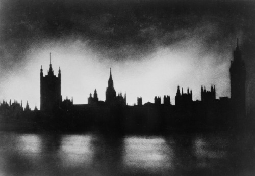 The Palace of Westminster in London, silhouetted against light from fires caused by bombings.