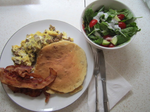 Relaxing at home on Sunday with some homemade brunch and a glass of lemonade. YUM! Hamburger Scrambled Eggs  Banana Walnut Pancakes Bacon  Arugula Salad with Grape Tomatoes and Cucumbers