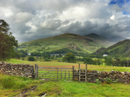Beddgelert from west sits beneath Yr Aran and Snowdon