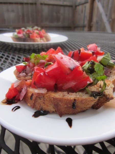 Summer tomato bruschetta from A Healthy Passion! You can use all those fire escape tomatoes you've been growing! I love bruschetta like even more than I love Murder She Wrote. No joke. [via Finding Vegan]