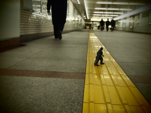 Hustle and Bustle. Little `Zilla at Tokyo Station, slogging to the Yamanote Line, after a long day of pillaging.