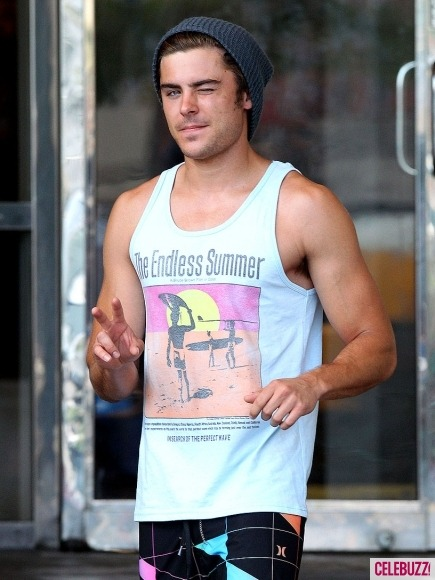 celebuzz:  Where can we get a ticket to this gun show? Zac Efron shows off his arms and gives the paps a wink as he steps out in New Orleans.  love. him.