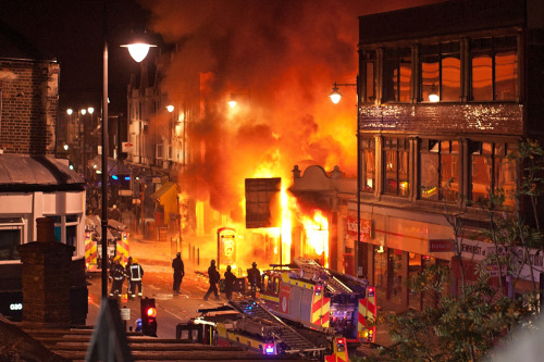 itjustneverwas:  Buildings burn on Tottenham High Road in London during protests on August 6, 2011. (Matthew Lloyd/Getty Images) #