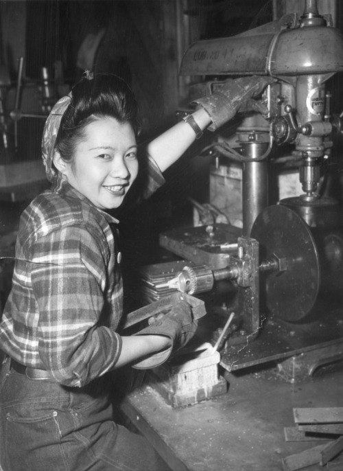 "softfilm:  Chinese-American Shipbuilder ""Los Angeles, Calif. — Miss Ethel Mildred Lee, 23-year-old girl born in this country of Chinese parents, is shown at her job as an electrician-helper at the Los Angeles yards of the California Shipbuilding Corporation, where she has worked for almost two years. Extra incentives to help the war effort are two brothers in the U.S. Army and one in the Navy yard at Honolulu, Hawaii. Miss Lee, who's 4 feet 10 inches tall and weighs 98 pounds, buys $100 worth of War Bonds a month."" — January 20, 1944"
