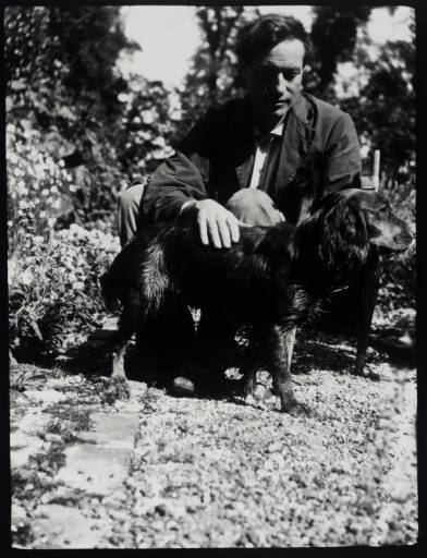 literarydogs:  The painter of Bloomsbury group Duncan Grant at Charleston with his pet dog Clinker in 1928.