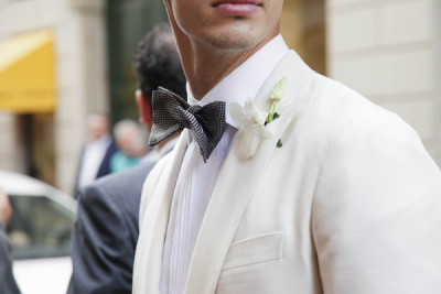 Nice bowtie. Love the white shirt & cream suit.