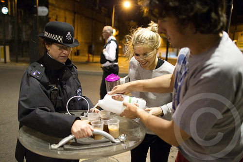 "00:38 9/8/2011: Camden Town, London by pixel.eight on Flickr. As looters and rioters smashed up shops, looted and fought with police in Camden Town, Philippa Morgan-Walker, 25 and her husband, Jonny Walker, 31, made tea for the police who were protecting their street. Some of the officers had been on duty for more than 30 hours. Please note that dude is called ""Johnny Walker"""
