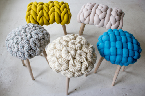 "giant knit stools. outsapop explains and suggests how to do something similar:  UK-based textile designer Claire-Anne O'Brien loves playing with the textural elements of knitting stitches. The  oversized knitting ""threads"" are fabric tubes filled with stuffing and  then braided/crocheted/weawed/knitted to look like the real thing. Wanna try this the trashion way? Use old pantyhose as tubes. (via :::: OutsaPop Trashion blog ::::: Claire-Anne O'Brien giant knit stools)"