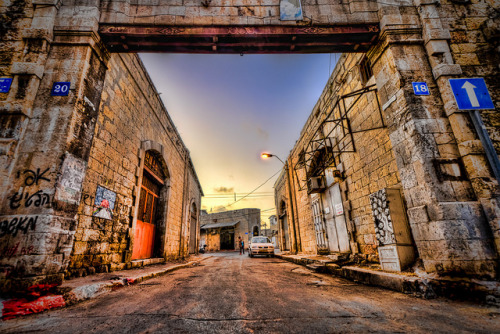 Jaffa Streets HDR on Flickr.Via Flickr:How it was shot: * Tripod * Three exposures (0, -2, +2 EV) autobracketed and merged to get and HDR * Camera: Nikon D7000 * Lens: Nikon AF-S Nikkor 10-24mm f/3.5-4.5G ED DXSteps Taken * Preparation: developed the raw files with Adobe Camera Raw (CA + Lens Corrections) * Created two additional exposures in ACR (+4EV and -4EV) to preserve highlights and shadows * Resulting images (5x TIFF) + Topaz Denoise on each TIFF, then imported to Photomatix * Tone-mapping: Photomatix Pro 4.1Photoshop Post Processing Steps: * Topaz Adjust * Topaz DeNoise * Selective Sharpening using Topaz Remask + in focus * Selective Saturation & Levels to Doors, Frame * Global saturation layer * Global levels layer To learn more about HDR Photography please check out the following 2 sites - they have taught me most of what I now know:Trey RatcliffHDR Cookbook