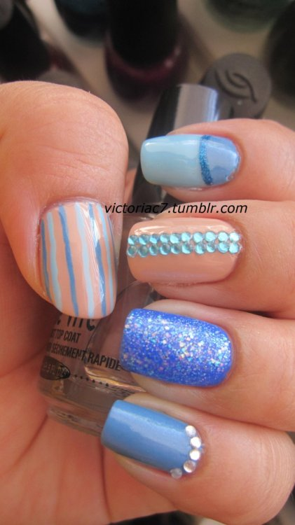 victoriac7:  Another mixed mani! Colors used: Essie - Coat Azure Sally Hansen X-treme Wear - Pacific Blue Sally Hansen Complete Salon Manicure - Cafe Au Lait Sinful Colors - Hottie OPI - What's With The Cattitude LA Colors Striper - Blue Glitter