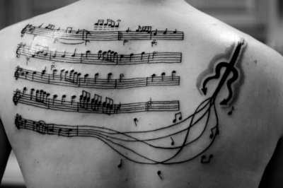 cccoooooooollllll……. XD   fuckyeahtattoos:  This is the sheet music for the song my wife walked down the aisle to. Done by Kelly at The Tattoo Lady shop in IN.
