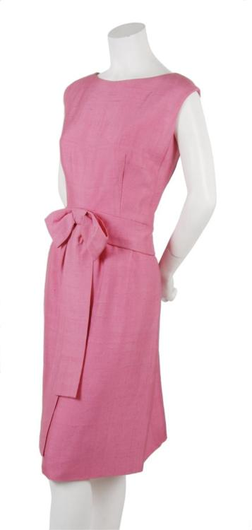 A simple linen shift dress with a lovely bow detail at the waist by Michel Goma, circa 1960.