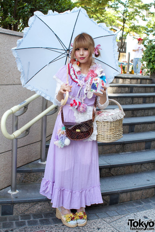 bringingshadyback:  Totally adorable Harajuku girl rocking a parasol (via tokyofashion.com). In addition to the cute parasol, I'm coveting the lavender dress with pompoms dangling from the craftsy collar.