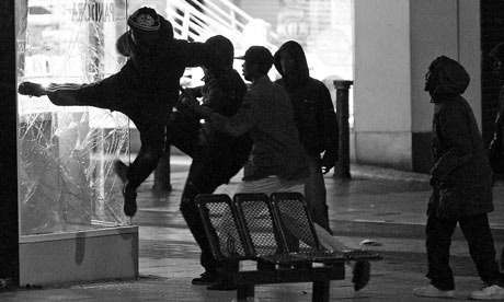 loveandhisthings:  Rioters in London breaking a shops windows.