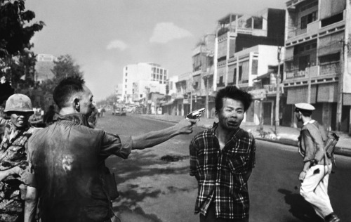 Vietnamese General Nguyen Ngoc Loan executing Nguyen Van Lem, member of the Vietcong, in front of an American reporter during the Tet Offensive. At this point in the photo the bullet had already been fired and was lodged inside Lem's head. Saigon - February 1st, 1968