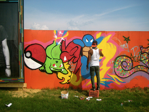albotas:  Daily Graffiti: An artist sprays the orignal Kanto starter Pokémon along with Pikachu on a wall at the 2011 Bonnaroo music & arts festival. Pic by lasarahhh. Check out the Daily Graffiti Archives for more geektastic street art!