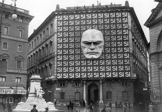 picturesofwar:  The headquarters of Benito Mussolini and the Italian Fascist party in Italy. The imposing face on the front entrance is that of Benito Mussolini himself. 1934.
