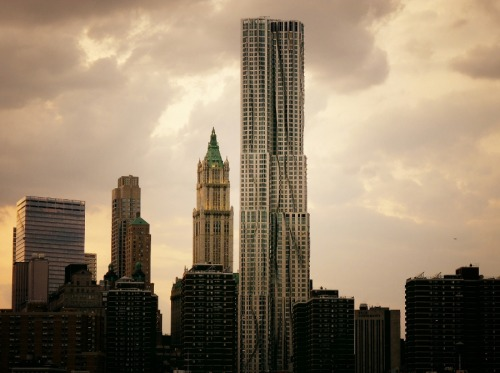 nythroughthelens:  New York by Gehry framed by dramatic storm clouds. 8 Spruce Street. Financial District, New York City.