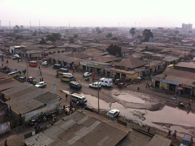 Downtown Kinshasa, a crazy maze of corrugated roof shacks and adhoc building,ribboned by potholed roads. There was so much electricity in this city you that felt on the verge of something all the time.Volcanic.-Remi