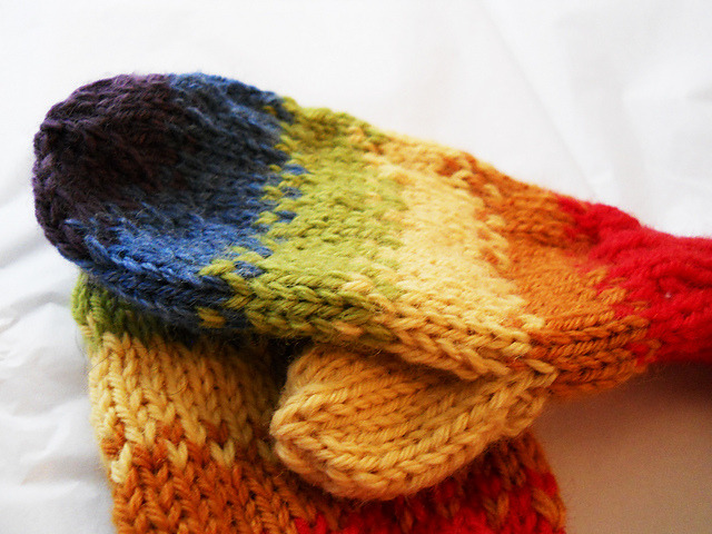 rocketorca:  Rainbow bag hat and mittens! These were made this past winter for my 6-year-old sister.  They were very fun to make and maybe one day, when I ever get the time, I will make some to sell. Made from a rainbow of Knit Picks Wool of the Andes.