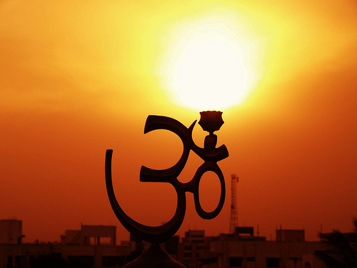 AUM Dispelling Darkness (by photographic Collection)