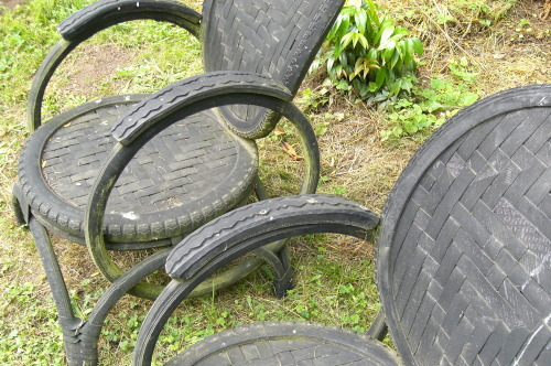 "Chairs made from recycled bicycle tires, located at the whimsical garden ""Bella Madrona"" in Sherwood, Oregon. The gardens were created by Jim Sampson and Geof Beasley which inspired a song by Pink Martini. Lyrics as follows: ""The Gardens of Sampson & Beasley"" Under Orion's starry sky I lie in the moonlit garden Wondering where to cast my eyeFor all that I see is heaven Oh why does it have to endI wish we could still pretend You're near, just around the bend In the gardens of Sampson and Beasley Last time we were in this place Your face had a certain sadness And oh how I've wondered since What you've done with all that sadness Oh why did it have to endI wish we could still pretend Our love was around the bend In the garden of Sampson and Beasley Under Orion's starry sky I lie in the moonlit garden Wondering when I close my eyes If I'll ever find my heaven Oh why will it never endThese days where I still pretendOur love just around the bend In the gardens of Sampson and Beasley"