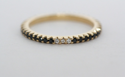 Custom engagement ring. 14K yellow gold with micro pave black diamonds and three white diamonds. I love this. For those of you you have been interested in getting this it is custom but contact info@mociun.com for more information on it.