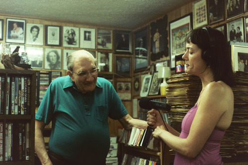 Rachel Hopkin interviewing Freeman Kitchens in his shop. July, 2011. Photo by J. Jameson.  Rachel Hopkin is a WKU Folk Studies graduate student who, for years, has produced radio pieces for the BBC. As a student in the program, she produces Folk Studies Radio for WKYU, Bowling Green's NPR affiliate. I just spoke with her about the status of a new piece she is working on in support of the upcoming exhibit on Mr. Kitchens. Last month she rode with me out to Drake on a routine visit with Freeman. That day, I showed him copies of his personal letter collection, given to folklorist Archie Green decades ago, and now sent over by the good folks at UNC's Southern Folklife Collection. She recorded our conversation as we skimmed through letters addressed to Freeman from members of the Carter Family Fan Club, musicians, and record collectors alike-circa the 1950s and 60s.  Rachel's radio piece on will air on WKYU before the exhibit opens (time TBD), and I'm glad to report that Nolan Porterfield—the great country music writer, host of the Old Scratchy Records show, and long-time patron of Drake Vintage Music & Curios—will be offering a few words on Freeman's deep musical history.