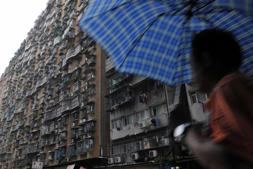 picturesoftheday:  A resident passed by an apartment in Macao, China.
