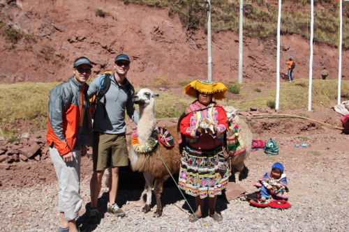 Day 4: Tour outside of Cusco. I find two highlights in this photo, making it post-worthy. First, the child's face reminds me of the overwhelming emotion of joy when opening a fresh Kit Kat bar; exciting. The second facet of this image revolves around the perfect posture of the llama. It's almost as if this is a usual happening. Showing off with pride, the lady holds a hearty guinea pig, which I must say tastes like fantastic lamb on a chicken wing. These characters stationed themselves near the vendor at a market outside of Cusco, where I'm pretty sure the guinea pig would be stuffed back in to a dark sack between tourist groups. Don't mind the brothers on the left. They're pretty legit travel partners.