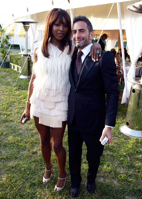 Naomi Campbell (in Givenchy) and Marc Jacobs, at the wedding of Kate Moss.  (via Vogue.com)