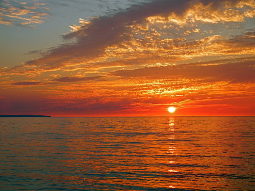 Slice of heaven… He lives. Lake Michigan Sunset Photographed by Ruby Adeline.