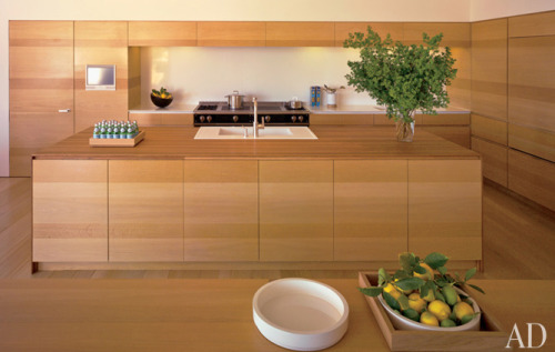 Oak cabinetry in the kitchen complements the La Cornue range and Caesarstone sink; the sink fittings are by Dornbracht.