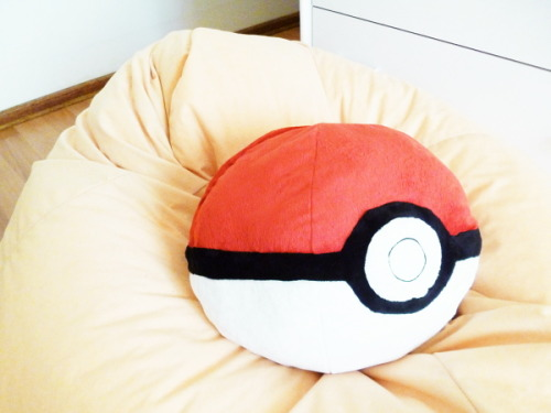 "frizzamabob:  Cute Thing #8: Pokeball Plush When I got this beanbag I decided to call it ""Pikachu"" because of its colour. Now it's complete."