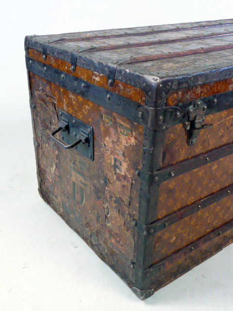 A rather well-loved Louis Vuitton steamer trunk — imagine the places it traveled.