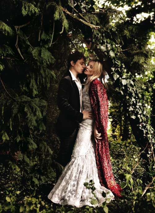 nittygrittydirtylittlefreaks:  vogue:  Kate Moss and Husband Jamie Hince Photographed for the September Issue of Vogue by Mario Testino  That dress thing is gorgeous.