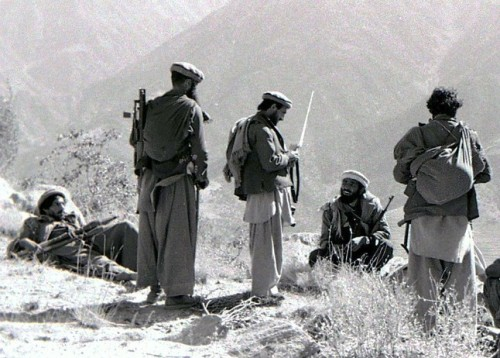 Mujahideen fighters in Afghanistan during the Soviet Invasion coordinating a mortar attack. Kunar Province, Afghanistan - 1987.