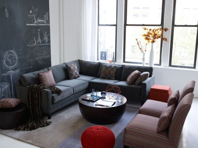 love the chalkboard paint wall behind the sectional
