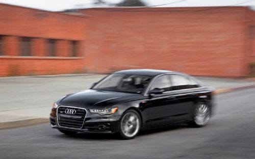 2012 Audi A6 3.0T Quattro  BASE PRICE  $50,775  PRICE AS TESTED  $71,330 		  VEHICLE LAYOUT  Front engine, AWD, 5-pass, 4-door sedan		  ENGINE  3.0L/300-hp/325-lb-ft supercharged  DOHC 24-valve V-6 		  TRANSMISSION  8-speed automatic		  CURB WEIGHT (F/R DIST)  4166 lb (55/45%)		  WHEELBASE  114.7 in		  LENGTH x WIDTH x HEIGHT  193.9 x 73.8 x 57.8 in		  0-60 MPH  4.8 sec		  QUARTER MILE  13.4 sec @ 103.9 mph		  BRAKING, 60-0 MPH  108 ft		  LATERAL ACCELERATION  0.91 g (avg)		  MT FIGURE EIGHT  25.4 sec @ 0.72 g (avg)		  EPA CITY/HWY FUEL ECON  19/28 mpg  ENERGY CONSUMPTION, CITY/HWY  177/120 kW-hrs/100 miles  CO2 EMISSIONS  0.87 lb/mile Read more: http://www.motortrend.com/roadtests/sedans/1107_2012_audi_a6_first_test/index.html#ixzz1UlUtx4oU