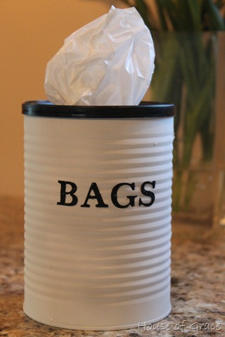 homemadecrap:  DIY Bag Holder (it's a coffee can!) via House of Grace way classier then shoving them in a drawer or at the back of the shelves…..