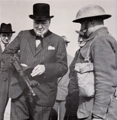 Winston Churchill inspecting the Tommy Gun of a British soldier. Hartlepool England, - July 31, 1940