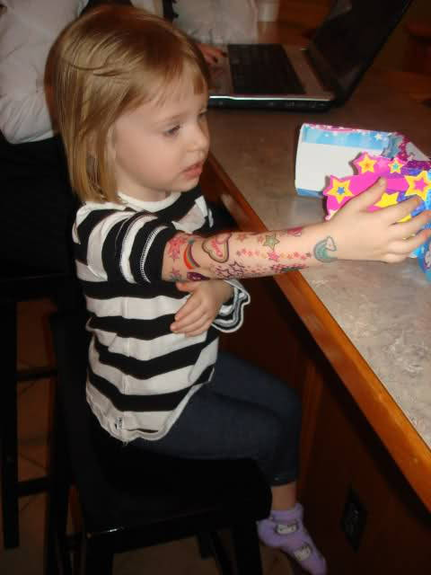 Hipster Toddler likes her tattoos.