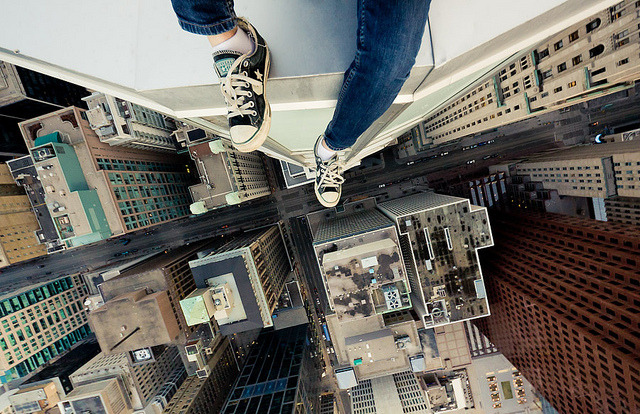 Rooftopping by tomms That looks like Toronto! laughingsquid:   Rooftopping, Taking Death Defying Photos From the Tops of Buildings  Via skyscraper