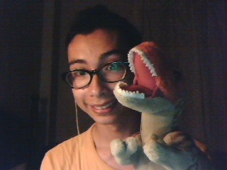 this is rexy. I got him at a dinosaur exhibition a few years back. he's really cuddly. :3 and he says hi. :3